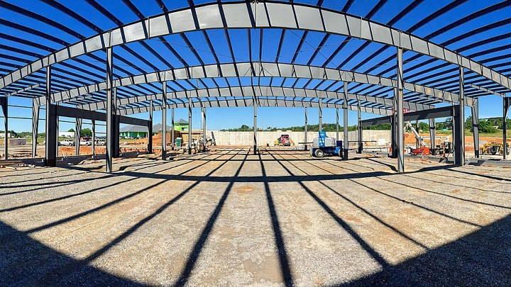 Picture of a construction site with an arched building frame