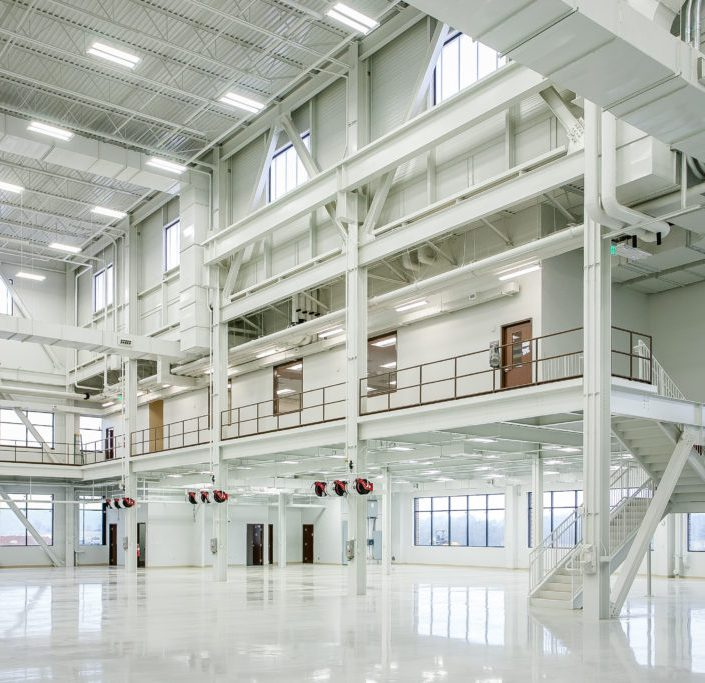 Open two floor room industrial room with polished floors and large windows