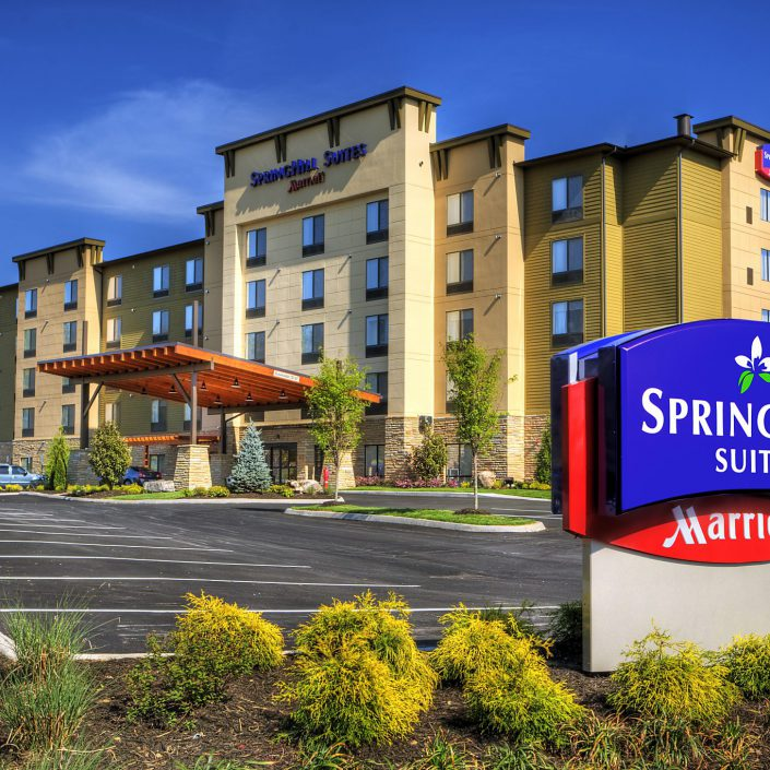 Front oof Spring HIll Suites with their sign clearly in view